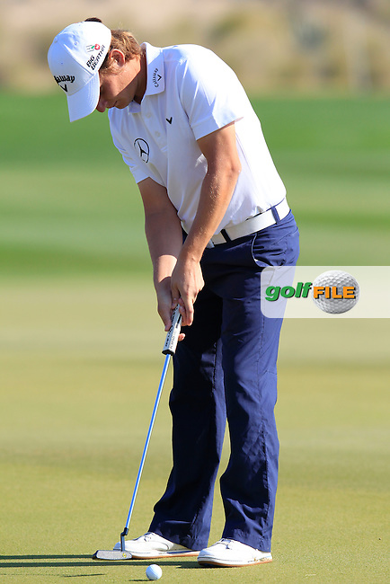 Emiliano GRILLO (ARG) takes his putt on the 9th green during Thursday's Round 2 of the 2015 Commercial Bank Qatar Masters held at Doha Golf Club, Doha, Qatar.: Picture Eoin Clarke, www.golffile.ie: 1/22/2015