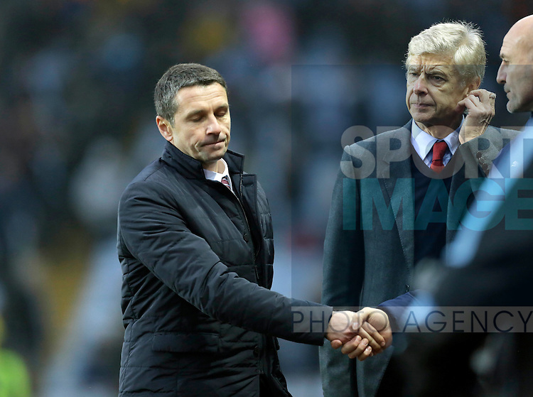 Arsene Wenger looks on as Villa manager Remi Garde shakes hands with Steve Bould - Football - Barclays Premier League - Aston Villa vs Arsenal - Villa Park Birmingham - 13th December 2015 - Season 2015/2016 - Photo Malcolm Couzens/Sportimage