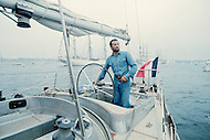 29 Jun 1976, Newport, Aquidneck Island, Rhode Island, USA. French sailor Eric Tabarly arrives in Newport aboard the Pen Duick VI after winning the OSTAR transatlantic race for the second time. The 1976 edition of the Observer Single-Handed Transatlantic Race (OSTAR) was the largest edition of the race, in the number of participants and the length of boats. Image by © JP Laffont