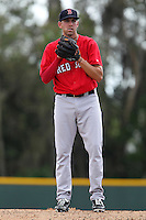 Boston Red Sox pitcher Matt Barnes #70 delivers a pitch during a minor league spring training game against the Baltimore Orioles at the Buck O'Neil Complex on March 23, 2012 in Sarasota, Florida.  Barnes was selected in the first round, 19th overall, of the 2011 MLB Draft.  (Mike Janes/Four Seam Images)