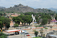 ANGOLA Quibala, church and fuel station of Sonangol, the state owned oil company / ANGOLA Kibala, Kirche und Tankstelle der staatlichen Oelgesellschaft Sonangol /