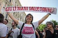 """Unknown, Activist """"Hands Off Women"""".  <br /> <br /> Rome, 01/05/2019. This year I will not go to a MayDay Parade, I will not photograph Red flags, trade unionists, activists, thousands of members of the public marching, celebrating, chanting, fighting, marking the International Worker's Day. This year, I decided to show some of the Workers I had the chance to meet and document while at Work. This Story is dedicated to all the people who work, to all the People who are struggling to find a job, to the underpaid, to the exploited, and to the people who work in slave conditions, another way is really possible, and it is not the usual meaningless slogan: MAKE MAYDAY EVERYDAY!<br /> <br /> Happy International Workers Day, long live MayDay!"""