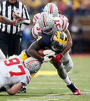 Ohio State Buckeyes linebacker Joshua Perry (37) and defensive lineman Joey Bosa (97) against Michigan Wolverines at Michigan Stadium in Arbor, Michigan on November 28, 2015.  (Dispatch photo by Kyle Robertson)