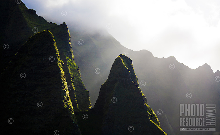 Peaks along the backlit, misty mountains of the Na Pali Coast, Kauai