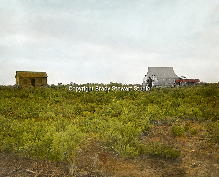 Jerome ID:  Temporary living facilities set up while the cabin is under repair - 1909.  Brady Stewart and three friends went to Idaho on a lark from 1909 thru early 1912.  As part of the Mondell Homestead Act, they received a grant of 160 acres north of the Snake River.  Brady Stewart photographed the adventures of farming along with the spectacular landscapes. To give family and friends a better feel for the adventure, he hand-color black and white negatives into full-color 3x4 lantern slides.  The Process:  He contacted a negative with another negative to create a positive slide.  He then selected a fine brush and colors and meticulously created full color slides.