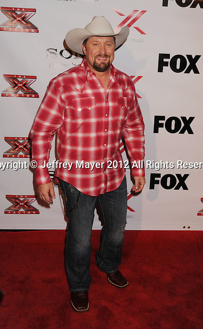 LOS ANGELES, CA - DECEMBER 06: Tate Stevens arrives at the 'The X Factor' Viewing Party Sponsored By Sony X Headphones at Mixology101 & Planet Dailies on December 6, 2012 in Los Angeles, California.