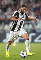 Calcio, Champions League: Juventus vs Siviglia: Torino, Juventus Stadium, 14 settembre 2016. <br /> Juventus&rsquo; Gonzalo Higuain in action during the Champions League Group H football match between Juventus and Sevilla at Turin's Juventus Stadium, 16 September 2016.<br /> UPDATE IMAGES PRESS/Isabella Bonotto