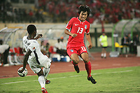 Ghana's Emanuel Agyemang-Badu (8) kicks the ball off of South Korea's Dong Ho Jeong (13) during the FIFA Under 20 World Cup Quarter-final match between Ghana and South Korea at the Mubarak Stadium  in Suez, Egypt, on October 09, 2009.