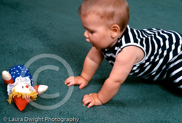 7 month old baby boy crawling toward toy horizontal Caucasian