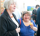 Students from the Supported Learning group at the opening of an exhibition of students' work, Harvey Gallery, Adult Learning Centre, Guildford, Surrey.