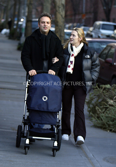 ***EXCLUSIVE -- FEE MUST BE AGREED BEFORE USE*** ..Kate Winslet and her hubby Sam Mendes take their newborn son Joe (born on December 22) for a stroll around a New York neighborhood. The 'Titanic' star walked hand in hand with her director husband for about 30 minutes to give little Joe a chance to get a breath of fresh air. On the way back, the happy couple greeted Kate's daughter Mia. While Mendes was seen pushing a stroller, Kate picked up her three-year-old daughter, Winslet's child with ex-husband Jim Threapleton, and gave her passionate hug and kiss while carrying Mia back home. New York, January 2, 2004. Please byline: NY Photo Press.   ..*PAY-PER-USE*      ....NY Photo Press:  ..phone (646) 267-6913;   ..e-mail: info@nyphotopress.com