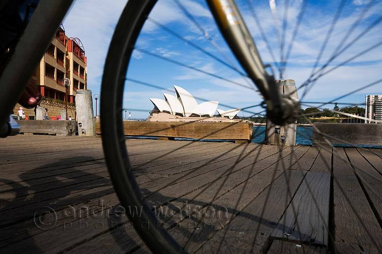 Cycling around Sydney Cove.  Sydney, New South Wales, AUSTRALIA.