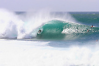 Jamie O'brien rides the barrel at Pipeline on Oahu's North Shore.