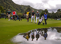 Harrison Endycott, Nick Voke and Andy Zhang walk down the 12th fairway on day one of the 2017 Asia-Pacific Amateur Championship day one at Royal Wellington Golf Club in Wellington, New Zealand on Thursday, 26 October 2017. Photo: Dave Lintott / lintottphoto.co.nz
