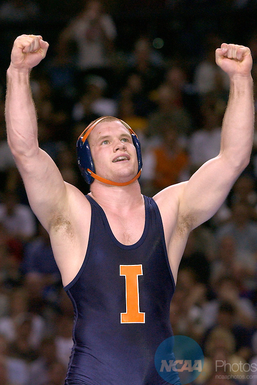 22 MAR 2003: Matt Lackey of Illinois (dark blue singlet) celebrates his win over Troy Letters of Lehigh in the 165 lb. championship round of the Division 1 Wrestling Championships held at Kemper Arena in Kansas City, MO.  Lackey defeated Letters 6-3.  Reed Hoffmann/NCAA Photos..