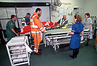 Paramedics and ambulance crews rush the victim of a road traffic accident into the crash room of an accident and emergency department. Doctors and nurses deal with the patient straightaway. The paramedics in orange are from  H.E.M.S. , the helicopter emergency medical service based in London...© SHOUT. THIS PICTURE MUST ONLY BE USED TO ILLUSTRATE THE EMERGENCY SERVICES IN A POSITIVE MANNER. CONTACT JOHN CALLAN. Exact date unknown.john@shoutpictures.com.www.shoutpictures.com...