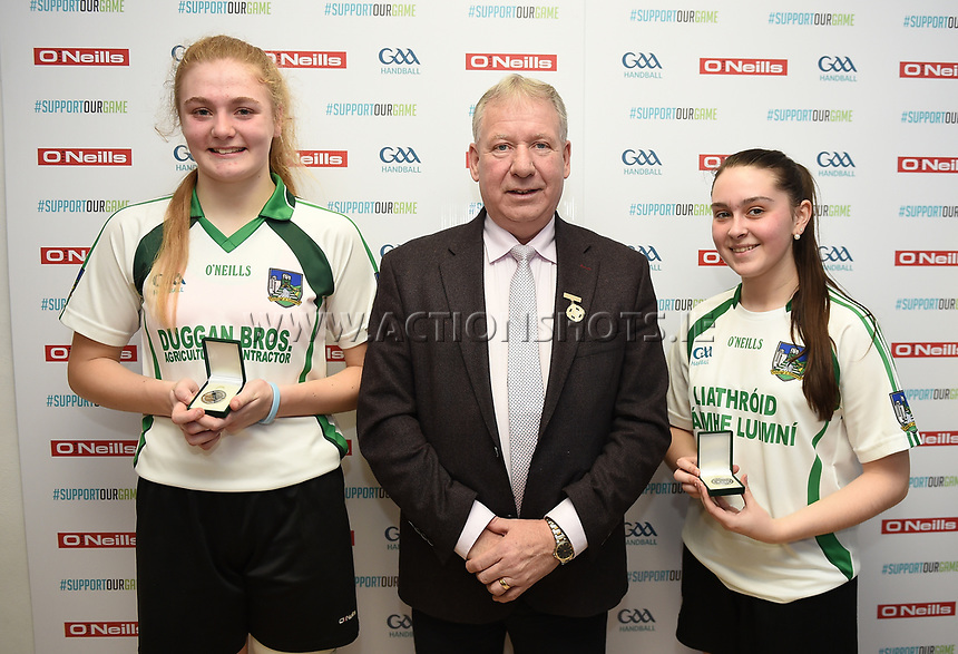 19/03/2018; 40x20 All Ireland Juvenile Championships Finals 2018; Kingscourt, Co Cavan;<br /> Girls Under-17 Doubles; Galway (Orla Whyte/Aoife Nic Dhonnacha) v Limerick (Ciara McCarthy/Keri Murphy)<br /> Keri Murphy and Ciara McCarthy with GAA Handball President Joe Masterson<br /> Photo Credit: actionshots.ie/Tommy Grealy