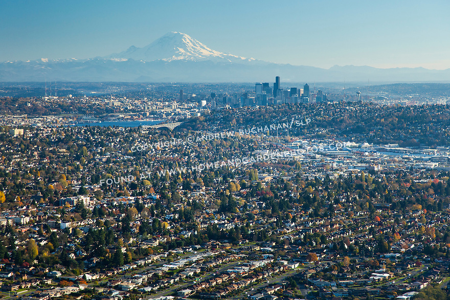Aerial photo of Seattle neighborhoods and downtown skyline with Mount Rainier in the background