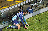 goalscorer Joe Jacobson of Wycombe Wanderers takes a breather after hitting the 'feeling great' Wycombe Leisure centre board during the Sky Bet League 2 match between Wycombe Wanderers and Yeovil Town at Adams Park, High Wycombe, England on 14 January 2017. Photo by PRiME Media Images.