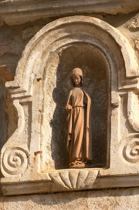 Religious statue. The village. Pommard, Cote de Beaune, d'Or, Burgundy, France