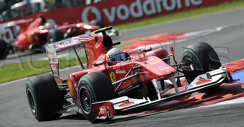Spanish driver Fernando Alonso of Ferrari drives ahead of his Brazilian teammate Felipe Massa during the 2010 Formula One Italian Grand Prix at the Autodromo Nazionale in Monza, Italy.