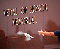 Women releases white dove during Medal of Honor Ceremony in Riverside California.