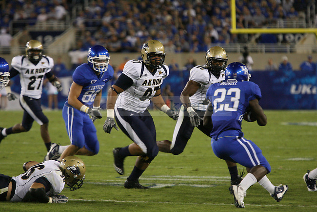 Donald Russell ran the ball against the  University of Akron at Commonwealth Stadium in Lexington, Ky on Sept. 18, 2010. Photo by Latara Appleby | Staff