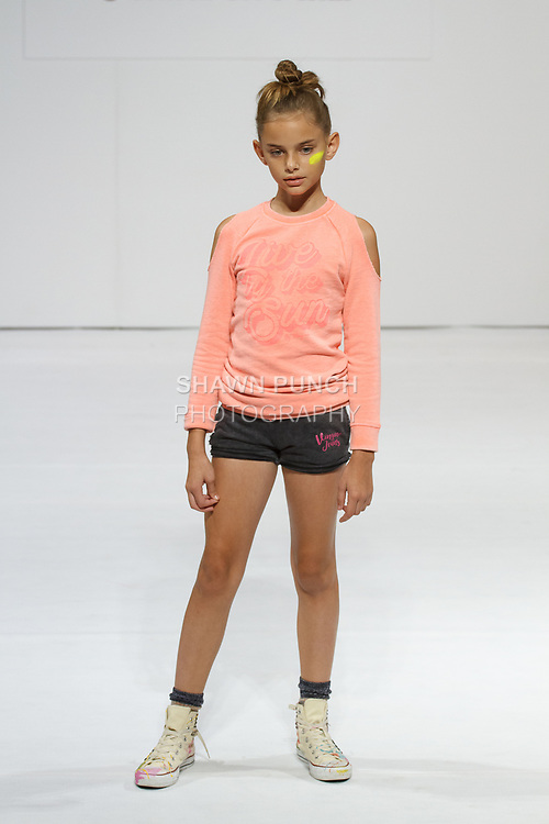 Model walks runway in an outfit from the Vingino Spring 2018 collection, for the petitePARADE Spring Summer 2018 fashion show with Children's Club, at Javits Center in New York City, on August 7, 2017.