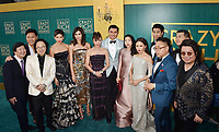 HOLLYWOOD, CA - AUGUST 07: (L-R) The cast of 'Crazy Rich Asians' Ken Jeong, Jon M. Chu, Jimmy O. Yang, Sonoya Mizuno, Gemma Chan, Michelle Yeoh, Henry Golding, Awkwafina, Constance Wu, Chris Pang, Nico Santos, Ronny Chieng and author Kevin Kawn arrive at the Warner Bros. Pictures' 'Crazy Rich Asians' premiere at the TCL Chinese Theatre IMAX on August 7, 2018 in Hollywood, California.<br /> CAP/ROT/TM<br /> &copy;TM/ROT/Capital Pictures
