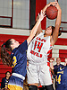 Taylor Abraham #14 of Freeport, right, looks to grab a rebound as Kathleen Doherty #12 of Massapequa tries to tip it away from her during a Nassau County AA-1 varsity girls basketball game at Freeport High School on Friday, Dec. 22, 2017. Massapequa won by a score of 43-39.