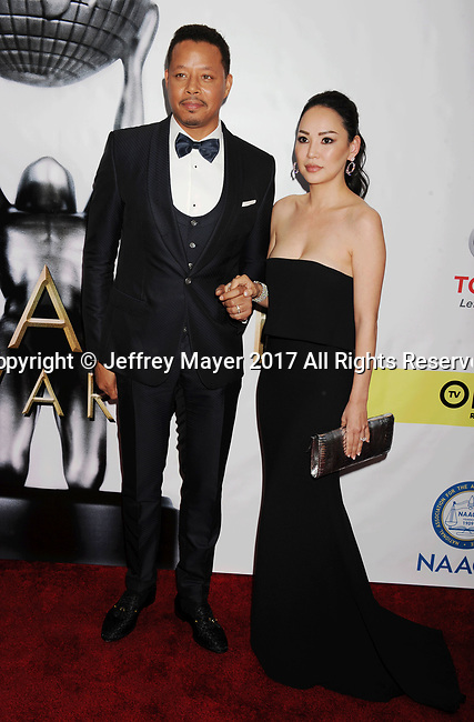 PASADENA, CA - FEBRUARY 11: Actor Terrence Howard (L) and wife Miranda Pak arrive at the 48th NAACP Image Awards at Pasadena Civic Auditorium on February 11, 2017 in Pasadena, California.