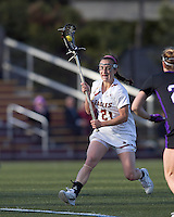 Boston College midfielder Kristin Igoe (21) on the attack. University at Albany defeated Boston College, 11-10, at Newton Campus Field, on March 30, 2011.
