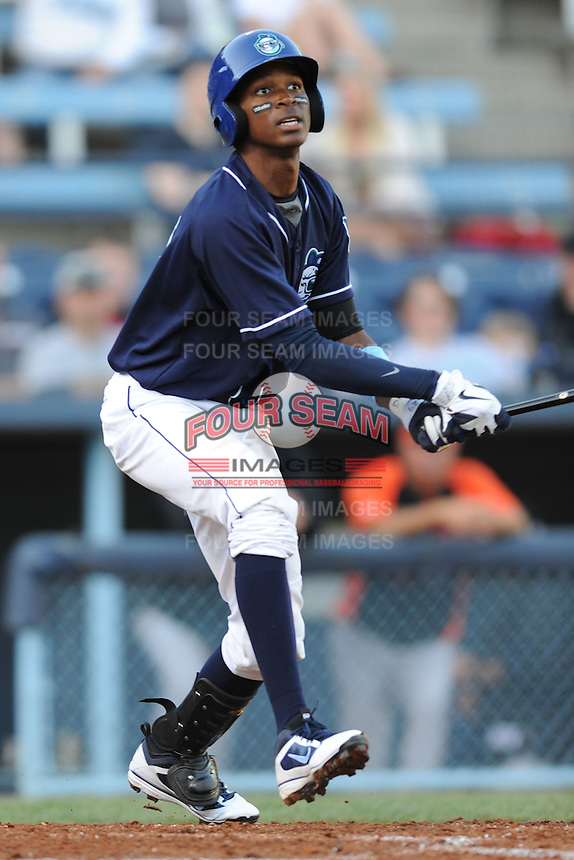 Asheville Tourists third baseman Rosell Herrera #29 swings at a pitch during a game between the Delmarva Shorebirds and the Asheville Tourists at McCormick Field, Asheville, North Carolina April 7, 2012. The Tourists won game one of a double header  8-4  (Tony Farlow/Four Seam Images)..