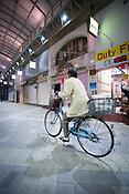 Bicycle through the Asakusa shopping arcade.