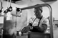 Trek-Segafredo team chef Kim Rokjaer preparing food in the team hotel kitchen for the riders on the 3rd Giro restday <br /> <br /> 101th Giro d'Italia 2018