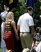 Bethesda, MD - July 1, 2009 -- Jessica Simpson, left, and Dallas Cowboys Quarterback Tony Romo, right, hold hands as they walk back stage during the opening ceremony of the AT&T National Hosted by Tiger Woods at Congressional Country Club in Bethesda, Maryland on Wednesday, July 1, 2009..Credit: Ron Sachs / CNP