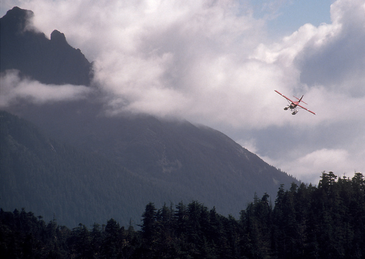 Alaska, A float plane banks for a landing on the west coast of Chichagof Island, West Chichagof-Yakobi Wilderness, Southeast Alaska, USA, plane: DeHavilland Otter, .