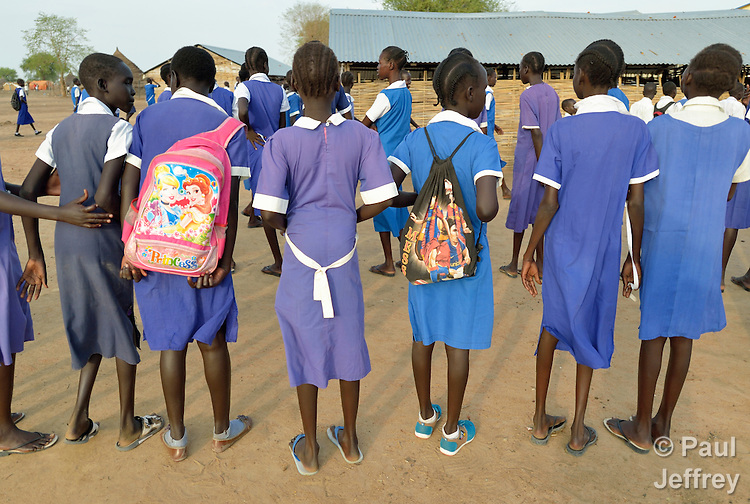 Girls line up in the Caritas-supported St. Daniel Comboni School in Agok, South Sudan, where tens of thousands of residents of Abyei, a contested region along the border between Sudan and South Sudan, remain displaced. Under a 2005 peace agreement, Abyei was supposed to have a referendum to decide which country it would join, but the two countries have yet to agree on who can vote. In 2011, militias aligned with Khartoum drove out most of Abyei's Dinka Ngok residents, pushing them across a river into the town of Agok. More than 40,000 Dinka Ngok have since returned to Abyei with support from Caritas South Sudan, which has drilled wells, built houses, opened clinics and provided seeds and tools for the returnees. Yet continuing insecurity means a greater number remain in Agok, where they remain dependant on Caritas and other organizations for food and other support.