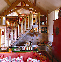 View from the sofa and small billiard table in the living room towards the original hayloft which is now a gallery bedroom