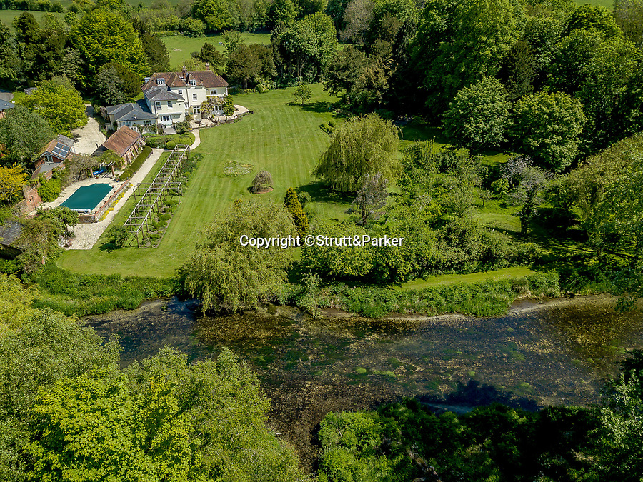 BNPS.co.uk (01202 558833)<br /> Pic: Strutt&Parker/BNPS<br /> <br /> The House sits on the river Itchen<br /> <br /> A breathtaking country home that comes with its own fishing rights in a well-stocked river has emerged for sale for £2.5m.<br /> <br /> Hockley House in the Hampshire village of Twyford sits on the banks of the river Itchen which runs between Winchester and Southampton.<br /> <br /> The stylish nine bed home has direct access to the 28 mile waterway and has a license allowing residents to fish in the grounds.