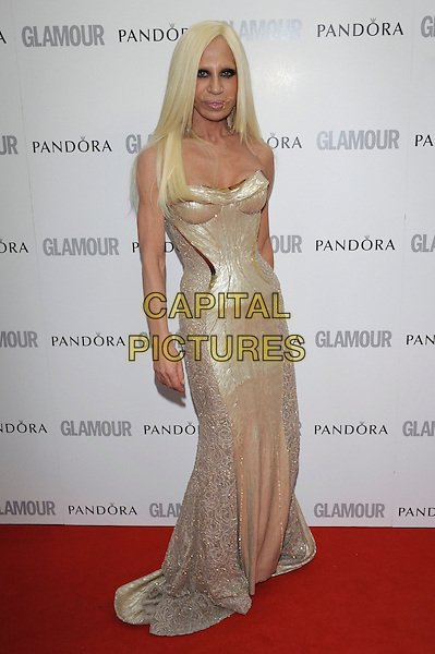 Donatella Versace.Women Of The Year 2012 - Glamour Awards, Berkeley Square, London, England..29th May 2012.full length gold corset strapless dress.CAP/PL.©Phil Loftus/Capital Pictures.