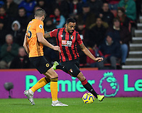 23rd November 2019; Vitality Stadium, Bournemouth, Dorset, England; English Premier League Football, Bournemouth Athletic versus Wolverhampton Wanderers; Callum Wilson of Bournemouth tries to get the cross in under pressure from Conor Coady of Wolverhampton Wanderers - Strictly Editorial Use Only. No use with unauthorized audio, video, data, fixture lists, club/league logos or 'live' services. Online in-match use limited to 120 images, no video emulation. No use in betting, games or single club/league/player publications