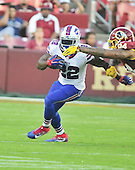 Buffalo Bills running back Reggir Bush (22) carries the ball in early first quarter action during the pre-season game against the Washington Redskins at FedEx Field in Landover, Maryland on Friday, August 26, 2016.  Redskins defensive end Preston Smith (94) defends.  The Redskins won the game 21 - 16.<br /> Credit: Ron Sachs / CNP