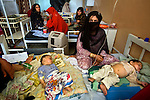 In the children's intensive care unit toddlers sleep two or three to a bed at Mirwais Hospital in Kandahar, Afghanistan, April 23, 2009. Despite worsening security, development continues at Mirwais Hosptial, where the International Committe of the Red Cross conducts training and assists the local staff. Mirwais is the main public hosptial serving five southern provinces. As security has deteriorated in the South, many international NGO's have pulled their staff from the area or shut down the regional office, stunting development in a region where it is badly needed.