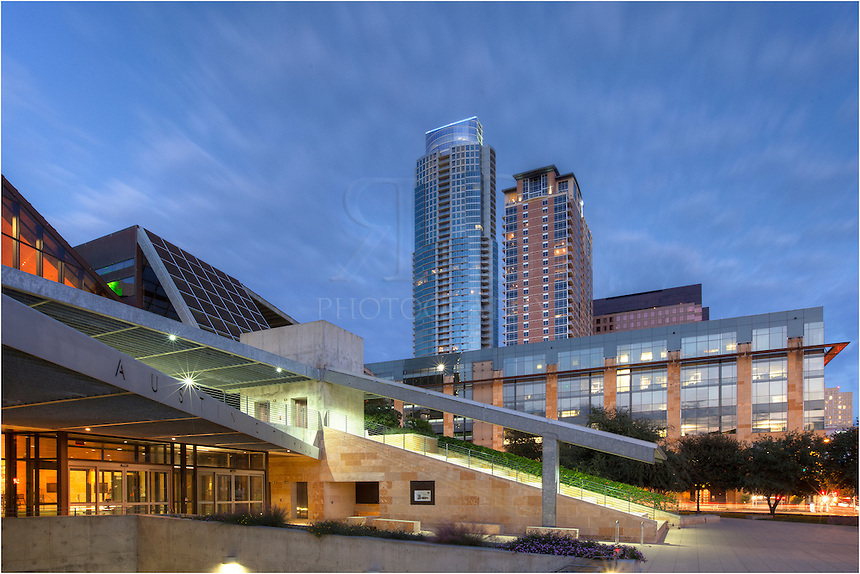 The new Austin City Hall building sits on the edge of the shores of Lady Bird Lake in the bustling downtown Austin Warehouse district.
