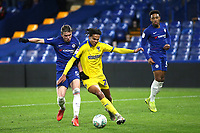 Conor Gallagher of Chelsea and AFC Wimbledon's Toby Sibbick challenge for the ball during Chelsea Under-21 vs AFC Wimbledon, Checkatrade Trophy Football at Stamford Bridge on 4th December 2018