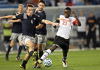 HOOVER, AL - DECEMBER 07, 2012:  Schillo Tshuma (23) of the University of Maryland pulls the ball away from Joey Dillon (4) of Georgetown University during an NCAA 2012 Men's College Cup semi-final match, at Regents Park, in Hoover , AL, on Friday, December 07, 2012. The game ended in a 4-4 tie, after overtime Georgetown won on penalty kicks.