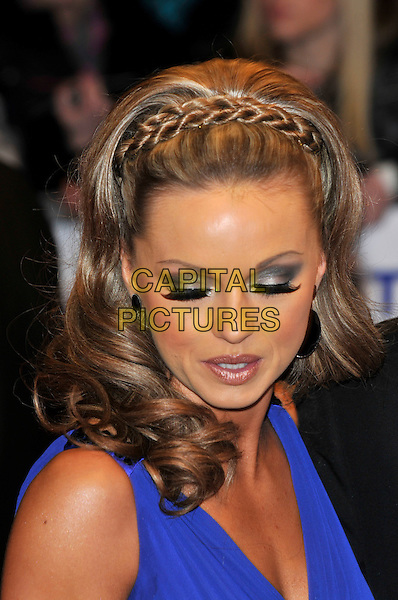 OLA JORDAN .The 15th National Television Awards held at the O2 Arena, London, England..January 20th, 2010.NTA NTAs headshot portrait blue purple indigo braid plait eyeshadow mouth open .CAP/PL.©Phil Loftus/Capital Pictures.