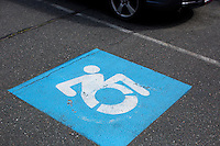 Parking spaces at Gordon College display the current version of the Accessible Icon. The icon, designed by the Accessible Icon Project, is a redesign of the International Symbol of Access (also known as the handicap symbol) that shows an active and engaged person with arms in motion.  Glenney's research focuses on the philosophy of perception and he maintains active interest in graffiti and street art.  The Accessible Icon has been adopted by cities and institutions around the world, including Gordon College, Nissan, New York City, Malden, MA, and others.