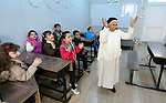 Sister Anahid, a member of the Dominican Sisters of St. Catherine of Siena, sings with students in a primary school she supervises in Dohuk, Iraq. Most of the students were displaced from their home villages when the Islamic State group took over portions of the Nineveh Plains in 2014. Because they came from communities with Arabic curriculum schools, they often don't fit well in schools in the villages where they resettled, because those schools teach in Kurdish or Assyrian. So the religious order started the school, which has students from several faiths, including Islam and Christianity. The Christian Aid Program Nohadra - Iraq (CAPNI) provides transportation for many students to Dohuk from the rural villages where their families have taken refuge.